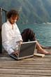 man writing on the laptop