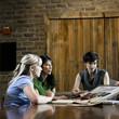 three women selecting flooring