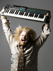 man holding a keyboard