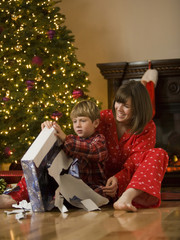 mother and son opening a christmas present