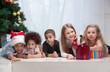 Leinwanddruck Bild - Children holding Christmas gifts