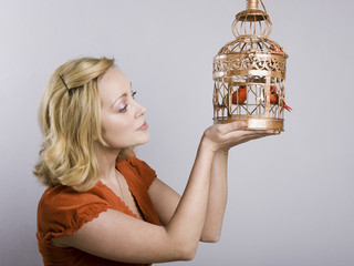 woman holding a birdcage