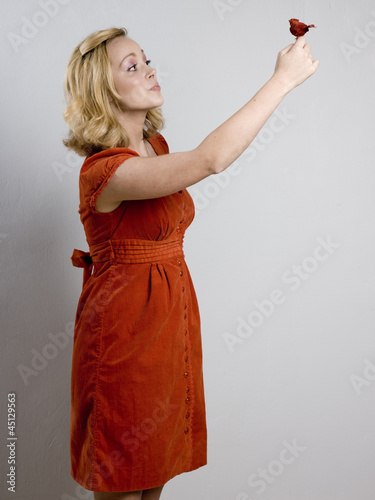woman holding a bird
