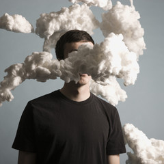 man standing in a cloud of smoke