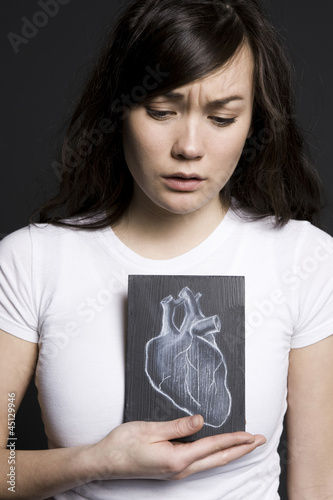 Woman with a drawing of a heart