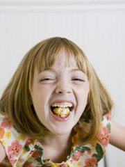 girl laughing with a mouth full of food