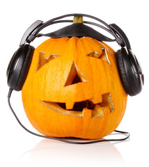 Halloween Pumpkin.Scary Jack O'Lantern in headphones