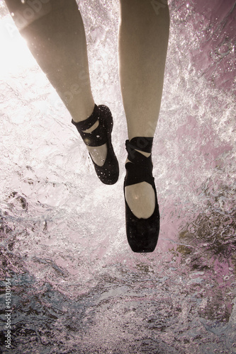 woman in a pool with ballet shoes on