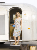 woman standing outside her airstream classic trailer