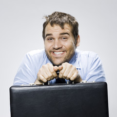 disheveled looking man with a briefcase