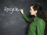 woman writing recycle on a chalkboard