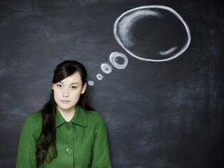 woman in front of a chalkboard