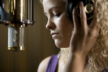 singing in a recording studio