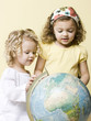 little girls with globe