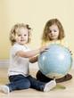 little girls with globe