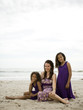 """USA, California, Los Angeles, Portrait of mother with daughters (6-11) on beach"""