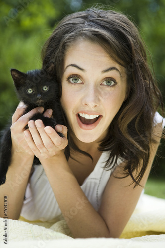 """USA, Utah, Orem, Portrait of woman holding kitten"""