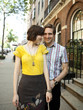 """USA, New York, New York City, Portrait of young couple in front of apartment building"""