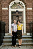 """""""USA, New York, New York City, Portrait of young couple in front of apartment building"""""""