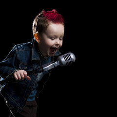 little boy singing into a microphone