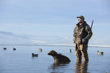man and his dog duck hunting