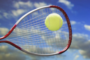 racket hitting a tennis ball