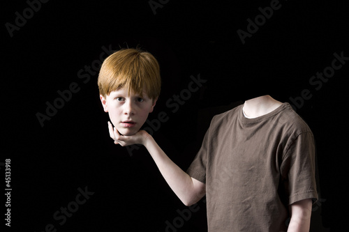 boy holding his decapitated head in his hand