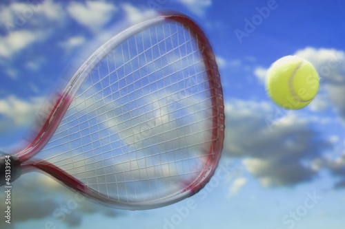 racket hitting a tennis ball