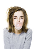 girl with a messy appearance popping a bubble gum bubble