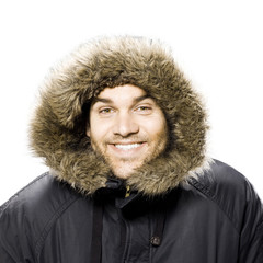 man wearing a winter coat with a fur trimmed hood