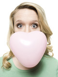 woman blowing a heart shaped bubble