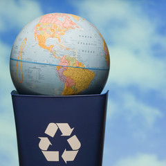 globe in a recycling bin