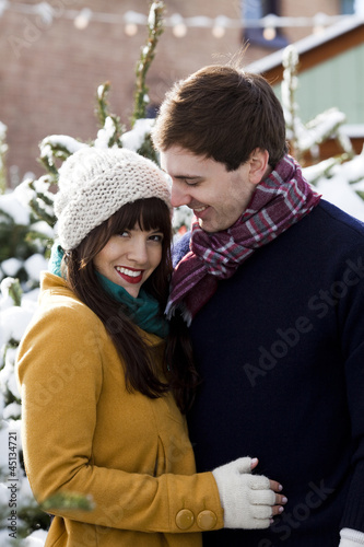 young couple together in the snow