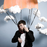 businessman parachuting