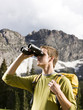 male hiker with binoculars