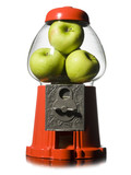 green apples in a gumball machine