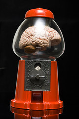 human brain in a gumball machine