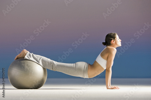 woman rolling on a swiss ball