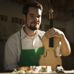 violin maker in the workshop