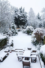 Snow covered garden and patio