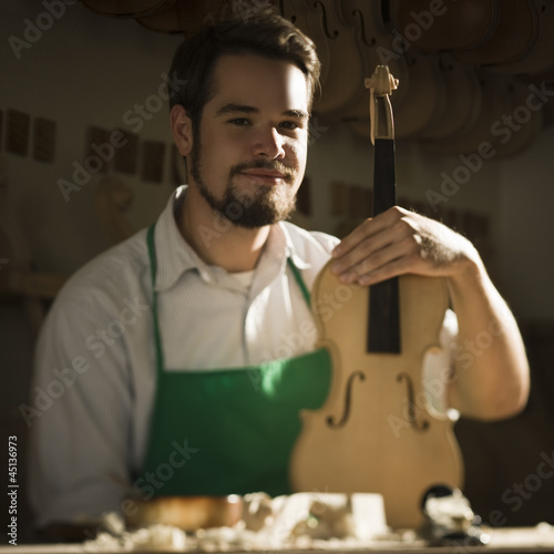 violin maker in the workshop