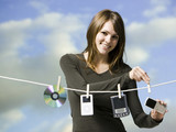 woman hanging electronics out to dry