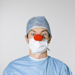 surgeon wearing a red clown nose