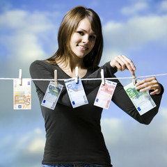 woman hanging money out to dry