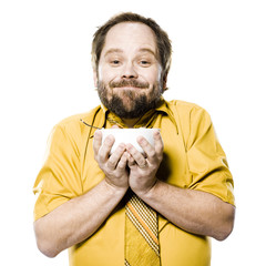man holding a bowl of cereal