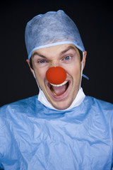 surgeon wearing a creepy clown nose