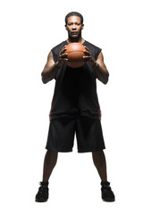 Mid adult man holding basketball
