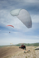 USA,Utah,Lehi,Mature male parachutist taking off,side view