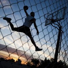 USA,Utah,Salt Lake City,Basketball player slam dunking ball