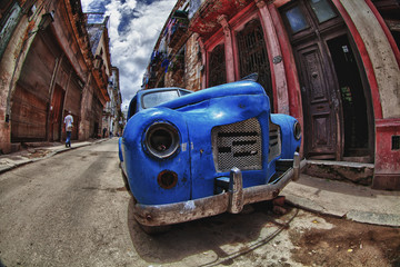 Abandon old car in the street of Havana